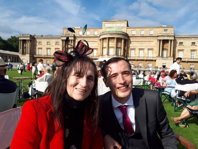 Andy Baker and his mum at the Queen's garden party
